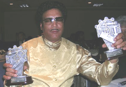 Goldee Heart Pictured with Two Awards Won